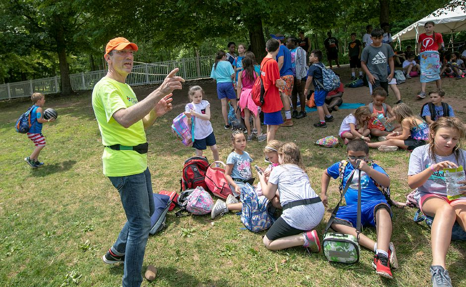 Dr. Cem Demirci, the medical director of the Children's Medical Center diabetes program, gets his group ready for the next activity during a pilot diabetes day camp at the YMCA's Mountain Mist Outdoor Center in Meriden, Thurs., Aug. 8, 2019. The camp is run in conjunction with the Children's Medical Center in Hartford, the Y, and funded through the Lion's Club. Dave Zajac, Record-Journal