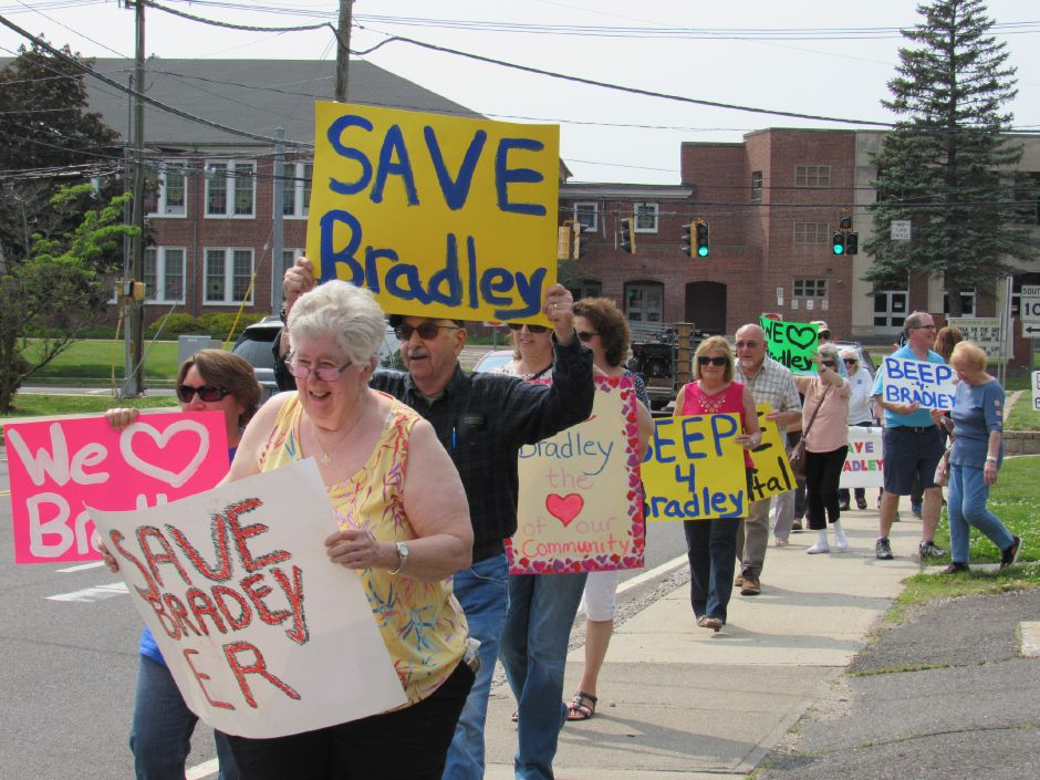 Diana Peake leads a group from the Community Committee to Save Bradley holding up signs and marching towards the hospital in a rally, Saturday, June. 1, 2019. | Jeniece Roman, Record-Journal.
