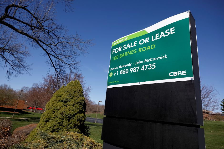 "A ""For Sale or Lease"" sign in front of a building at 100 Barnes Rd. in Wallingford, Wed., Apr. 7, 2021. The Wallingford police station might be moving to the location. The Town Council is scheduled to vote Tuesday on approving the purchase contract for the building and property. Dave Zajac, Record-Journal"
