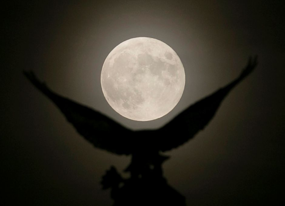 A full moon rises over the eagle atop the World War l monument on Broad Street in Meriden,Tues., July 16, 2019. Saturday marks the 50th anniversary of the moon landing. Dave Zajac, Record-Journal