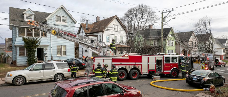 Meriden firefighters confer after a blaze at 94 Linsley Ave. in Meriden , Tues., Jan. 5, 2021. Dave Zajac, Record-Journal