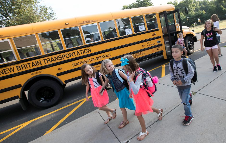 FILE: Students step off the bus and head into Thalberg Elementary School on the first day of school in Southington, Thursday, August 31, 2017. | Dave Zajac, Record-Journal