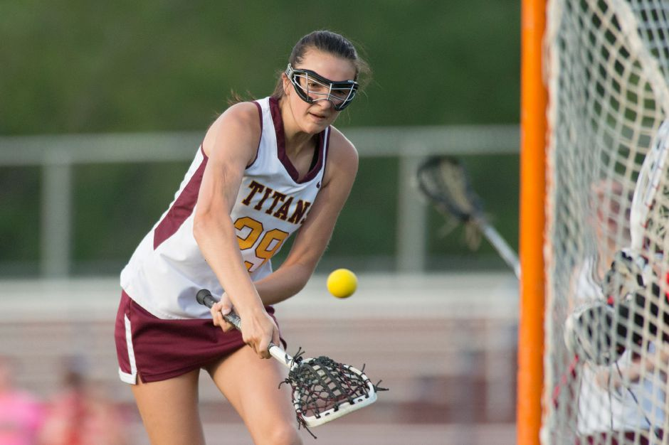 Carlee Crispens scored four goals and assisted on three others in the Sheehan girls lacrosse team's 15-8 victory over Jonathan Law on Tuesday in Wallingford. | Justin Weekes / Special to the Record-Journal