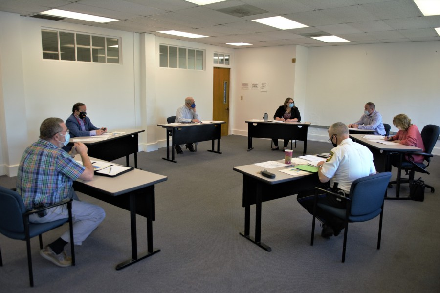 The Wallingford Police Station Steering Committee met for the first time at the Wallingford Town Hall on May 13. Police Chief William Wright [lower right corner] discusses the proposed station with committee members. | Nick Sambides Jr., Record-Journal
