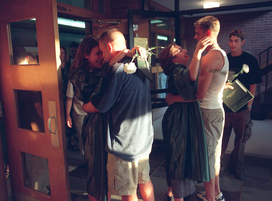 RJ file photo - Josh Lamay congratulates his girlfriend Dawn Perito (left) after the graduation ceremony at Maloney High Wednsday night June 23, 1999.