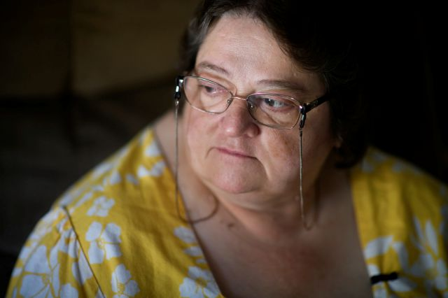 "THIS CORRECTS THE SPELLING OF THE LAST NAME TO KELLEY, AND NOT KELLY AS ORIGINALLY SENT - Doris Kelley, 57, sits in her home on Monday, June 29, 2020 in Ruffs Dale, Pa. Kelley was one of the first patients in a University of Pittsburgh Medical Center trial for COVID-19. ""It felt like someone was sitting on my chest and I couldn't get any air,"" Kelley said of the disease. (AP Photo/Justin Merriman)"