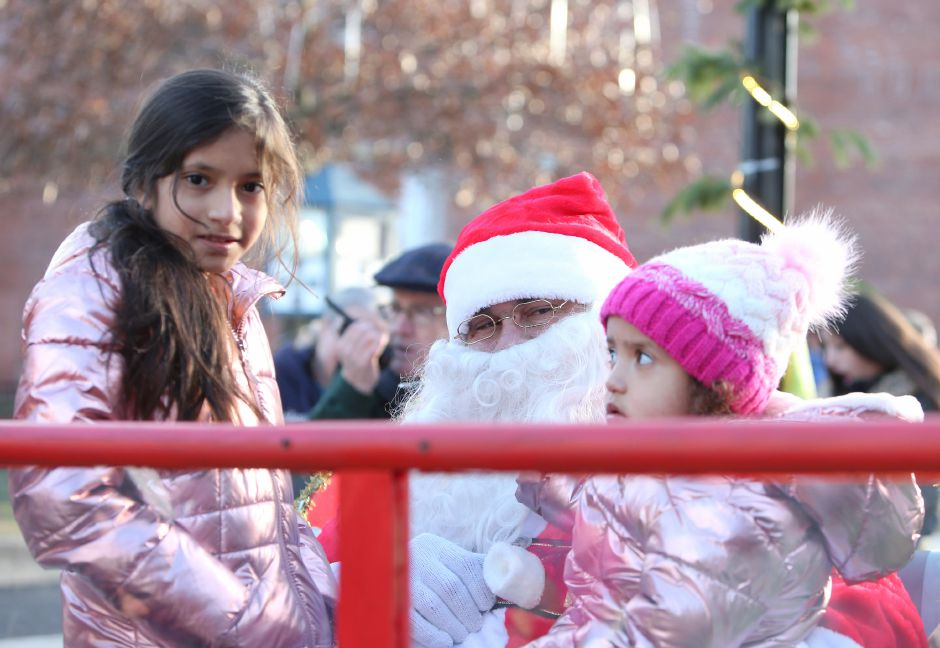 Valerie, 9, and Destiny Rodrigues, 3, of Meriden, meet Santa outside of the Meriden train station during the annual Yulefest on Saturday, Nov. 30, 2019. Emily J. Tilley, special to the Record-Journal.