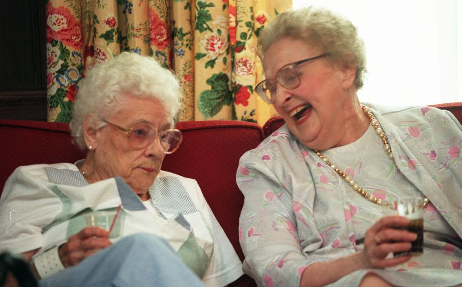 RJ file photo - Olivine Rancourt, left, and Mary Marks, right, are enjoying eachothers company during happy hour at Bradley Home in Meriden June 24, 1999.
