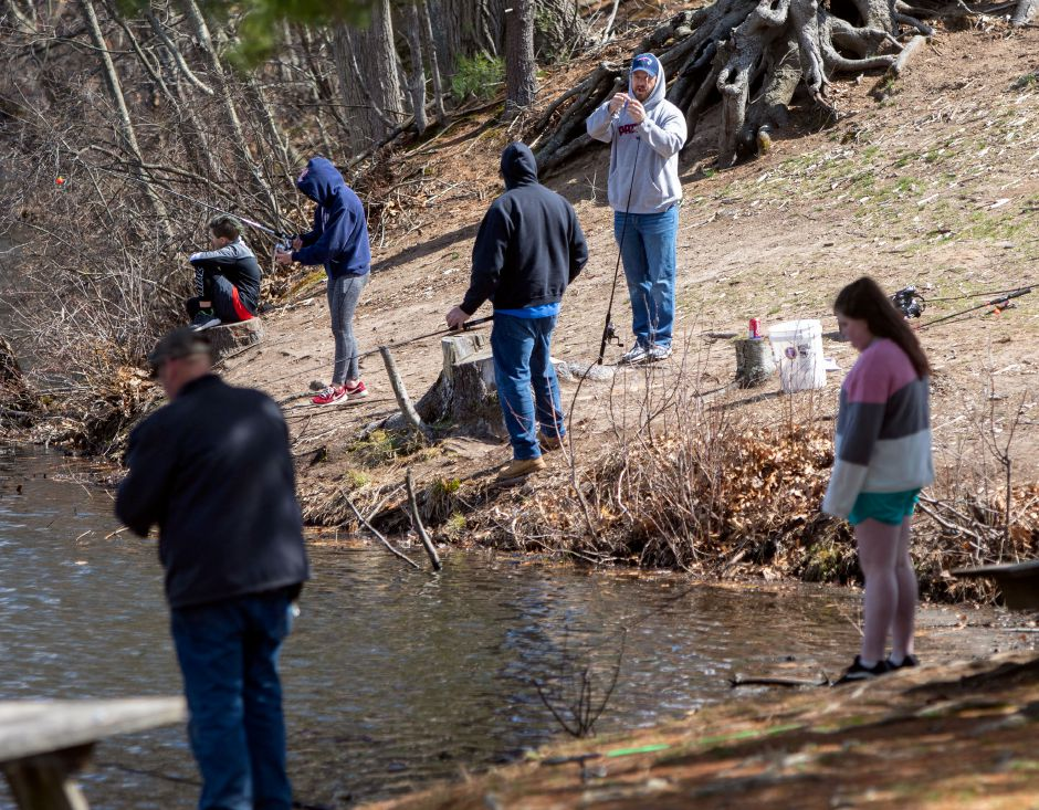 Fishermen keep their distance as they fish at Wharton Brook State Park in Wallingford on Wednesday. Photos by Aaron Flaum, Record-Journal