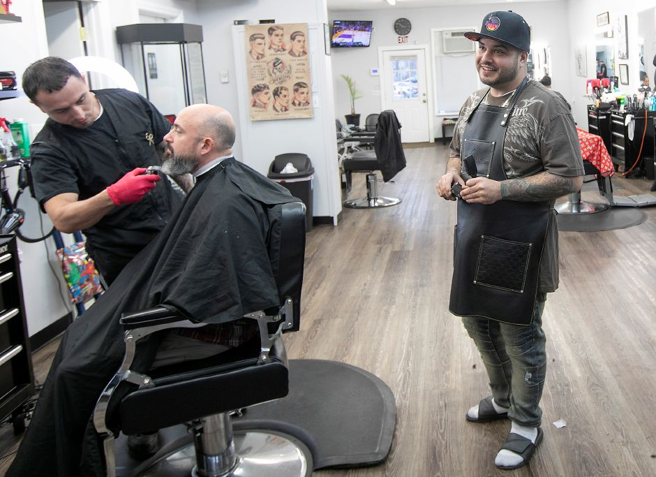 David Ortiz, owner of Classic Cutz, right, talks about the recent sale of the building his business is housed in at 35 N. Colony Rd. in Wallingford, Thurs., Dec. 26, 2019. Dave Zajac, Record-Journal