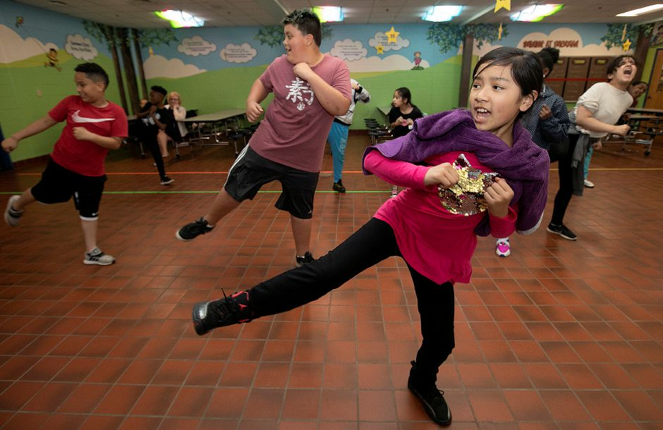 "FILE PHOTO: Fifth-grade student MeiLing Cheng, 10, practices kicks with her classmates during an extended-day karate program at Roger Sherman Elementary School, Wed., May 8, 2019. The school district is struggling to sustain its extended day programs in the elementary school but continues to promote a ""college culture"" even in lower grades. 