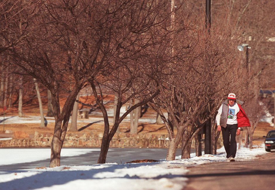 RJ file photo - Bill Hinrichs, 94, of Meriden, walks a lap around the Hubbard Park pond March 7, 1999. He intends to walk 12 kilometers in a charity event in April.