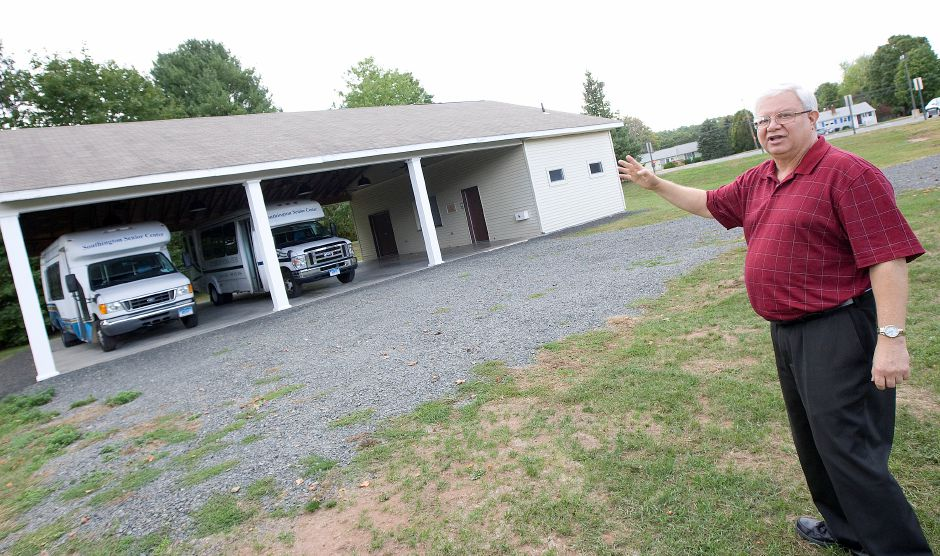 FILE PHOTO: Robert Verderame, executive director, shows the area where a new senior center will be built on the west side of the current Calendar House at 388 Pleasant St. in Southington, Monday afternoon, October 3, 2016. The carport housing the center