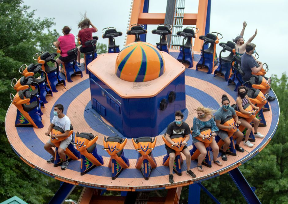 Riders wear  masks as they ride Rev-O-Lution at Lake Compounce. Visitors must wear a mask throughout the park and on rides, and will be seated by ride attendants for proper distancing.