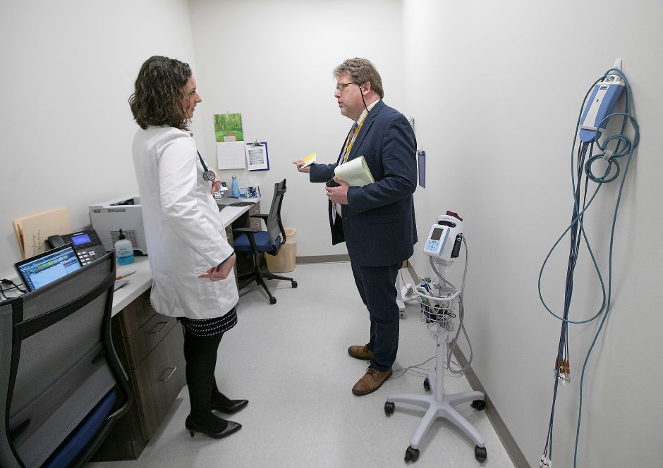 Emily Durocher, physician assistant, talks Thursday with Chris Boyle, hospital spokesman, in a work station at the new Bristol Health, 167 Main St. in Southington. Dave Zajac, Record-Journal
