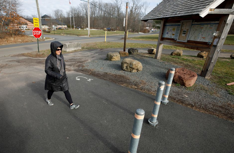 Karen Walsh, of Southington, turns around at the end of the Farmington Canal Heritage Trail at Lazy Lane in Southington on Wednesday. Town officials are continuing with plans to design the last portion of the Farmington Canal Heritage Trail that runs from Lazy Lane to the Plainville town line. Photos by Dave Zajac, Record-Journal