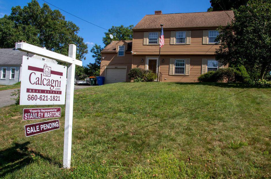 A house on Parker Avenue, in Meriden has a sale-pending sign in its front yard. The house recently sold. Aaron Flaum, Record-Journal