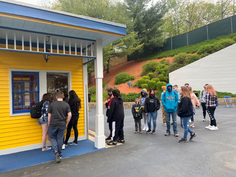 Customers pick up season passes at Lake Compounce on Saturday, the amusement park's opening day. Compounce is celebrating its 175th birthday this year. Faith Williams, Record-Journal