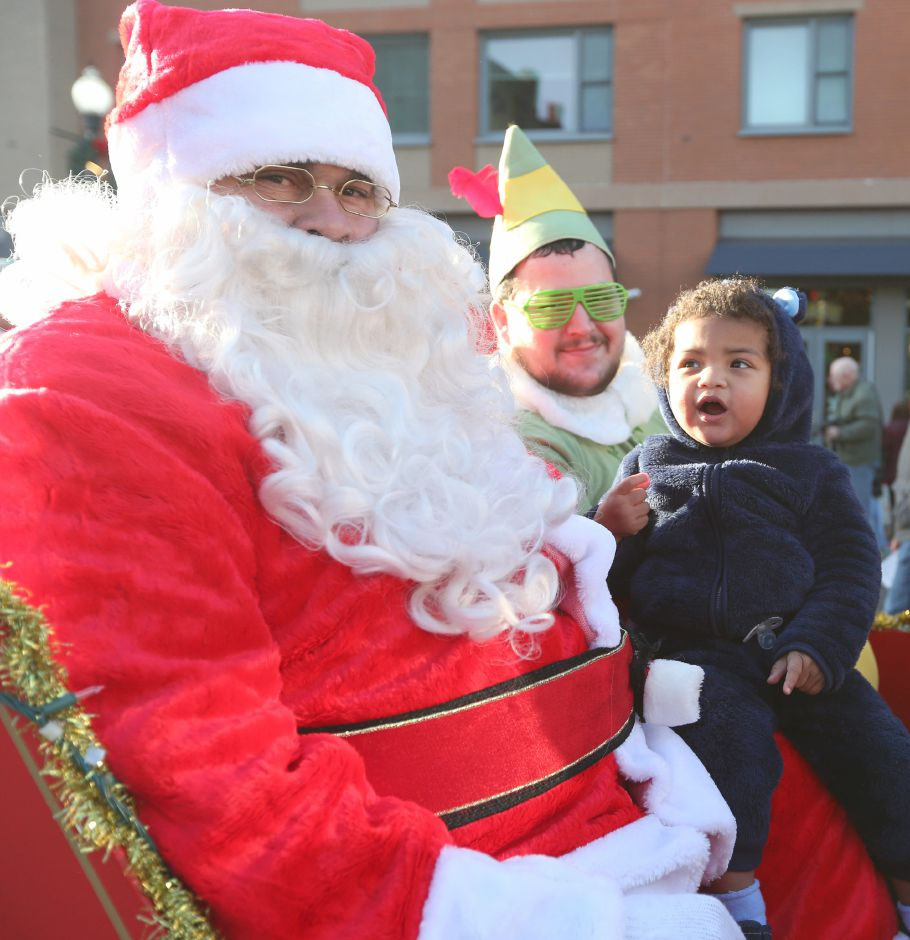 Jovi Orellana, 1, of Meriden, meets Santa for the first time during the annual Yulefest in Meriden on Saturday, Nov. 30, 2019. Emily J. Tilley, special to the Record-Journal.