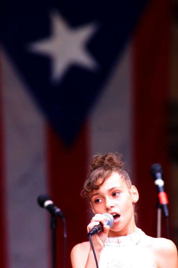 Angelica Zapata,10 of Waterbury sings several songs on stage in the James Barry Bandshell during the Puerto Rico Festival at Hubbard Park Sunday July 18, 1999.