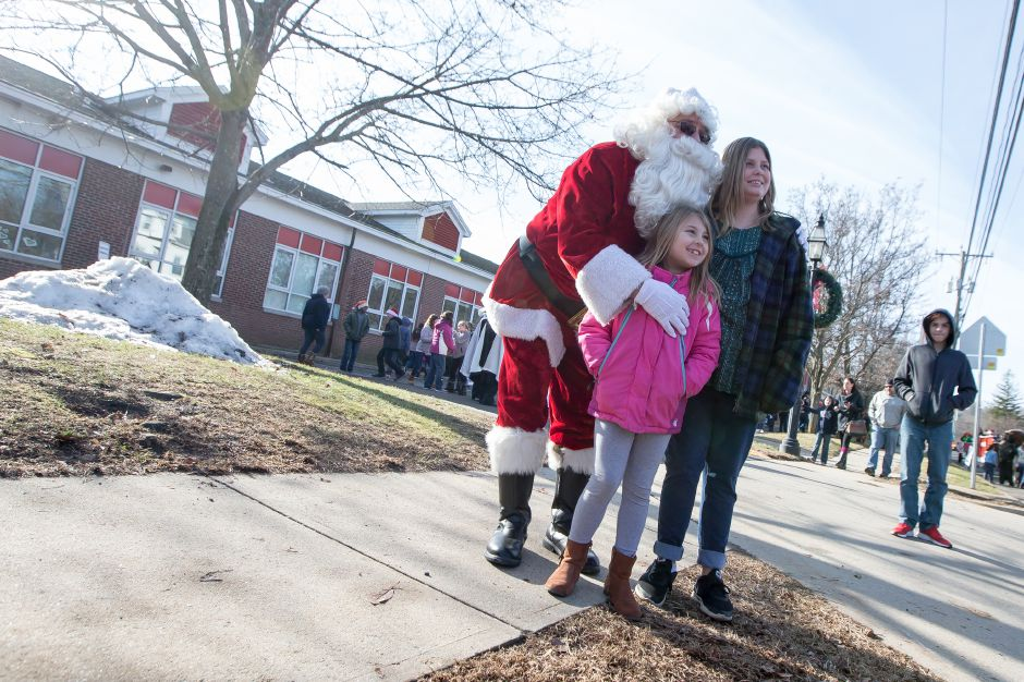 Natalie Lopez 7 and sister Juliana 11 get a photo with Santa Saturday during Christmas in the Village on Main Street in South Meriden December 1, 2018 | Justin Weekes / Special to the Record-Journal