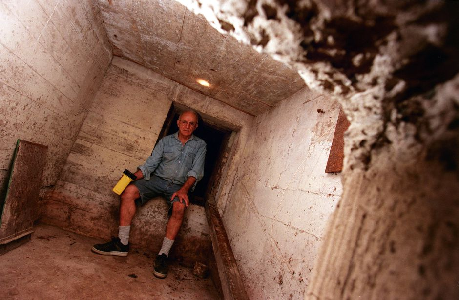 Joe Salonia of Meriden sits in his 40-year-old bomb shelter which is entered through a small tunnel from his basement Oct. 1999. He recently emptied the shelter of food and other survival provisions that he placed there in the late 1950