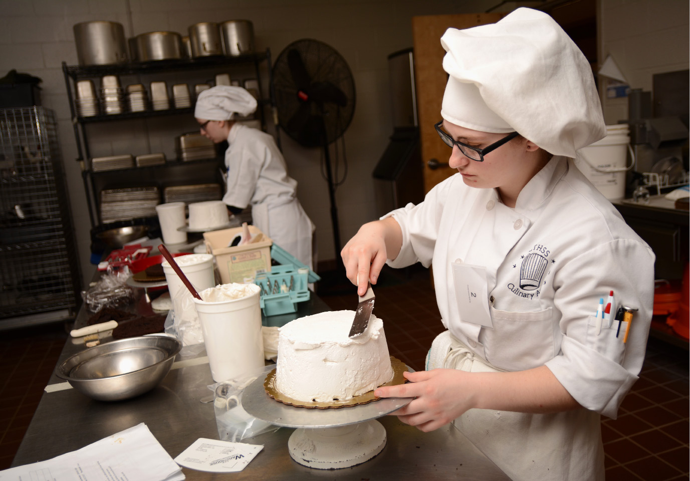 Lexi Hines, of Wilcox Technical High School, frosts a cake during a Skills USA competition at the school on Friday, March 31, 2017. | Bryan Lipiner, Record-Journal