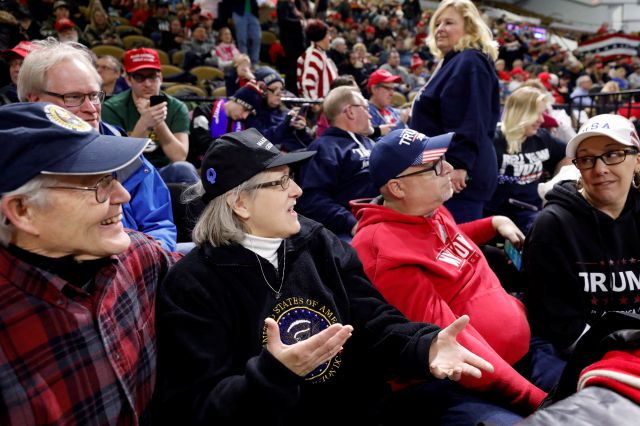 Randy Jacobson, left and Diane Jacobson speak to other Trump supporters beforef a campaign rally for President Donald Trump Tuesday, Jan. 14, 2020, in Milwaukee. (AP Photo/Jeffrey Phelps)