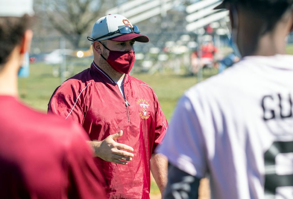 Sheehan baseball coach Dom Lombardozzi, seen here talking to his players before a scrimmage with Newington on Tuesday at Neubauer Field, will make an overdue debut Saturday when his Titans host Xavier. Lombardozzi is one of five new area spring coaches who were due to take up the reins in 2020 only to see the entire season cancelled by the pandemic. Aaron Flaum, Record-Journal