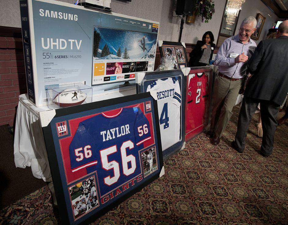 Silent auction items included N.F.L. jerseys during the 2018 United Way NFL Players