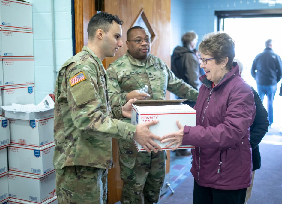 Virginia Bruen, of Berlin, takes a care package box from a soldier at the New Britain VFW for the Hero Boxes care package packing day on Nov. 9, 2019. The Berlin-based non-profit sends hundreds of care packages to soldiers serving in war zones each year. | Devin Leith-Yessian/Berlin Citizen