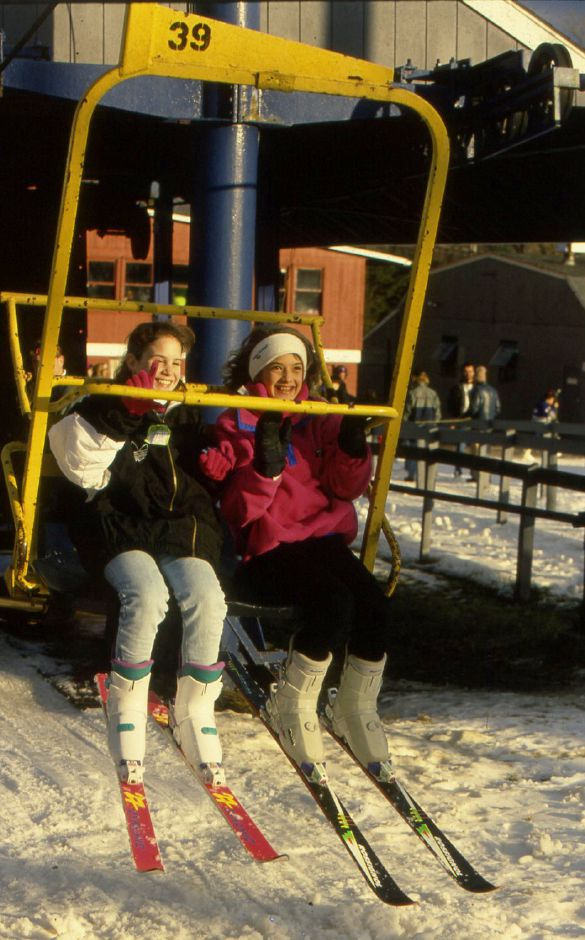 RJ file photo - Stacey Napolitano, left, and Jenn Goodman, both of Wolcott, are swept off their feet by the ski lift at Mount Southington Jan. 2, 1994.