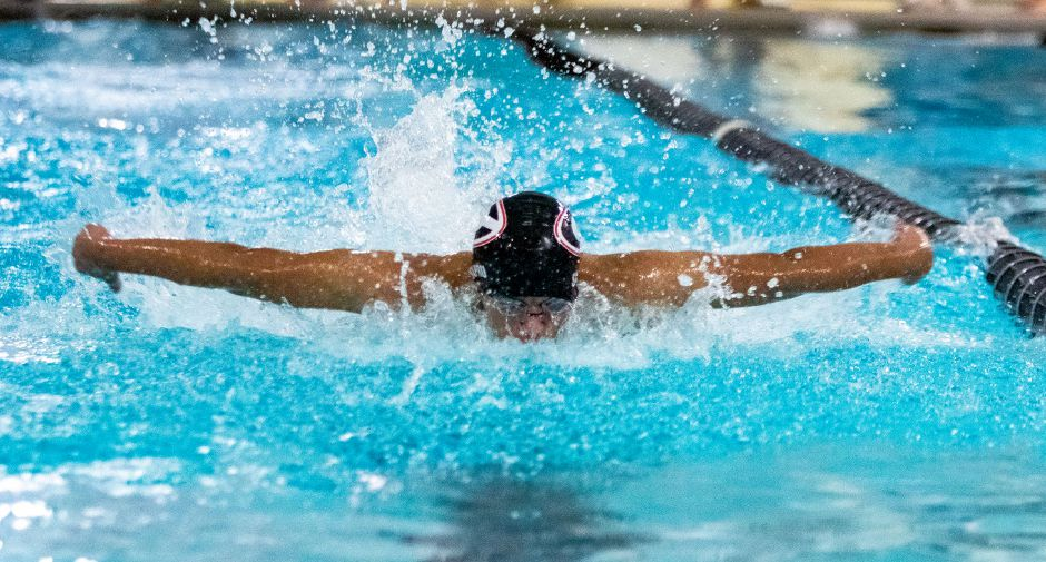 At right, Cheshire's Anmol Sapru swims the butterfly leg of the 200 Medley Relay.