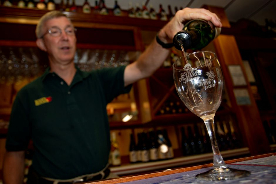Keith Bishop pours a sample of Happley Impeared wine at Bishop
