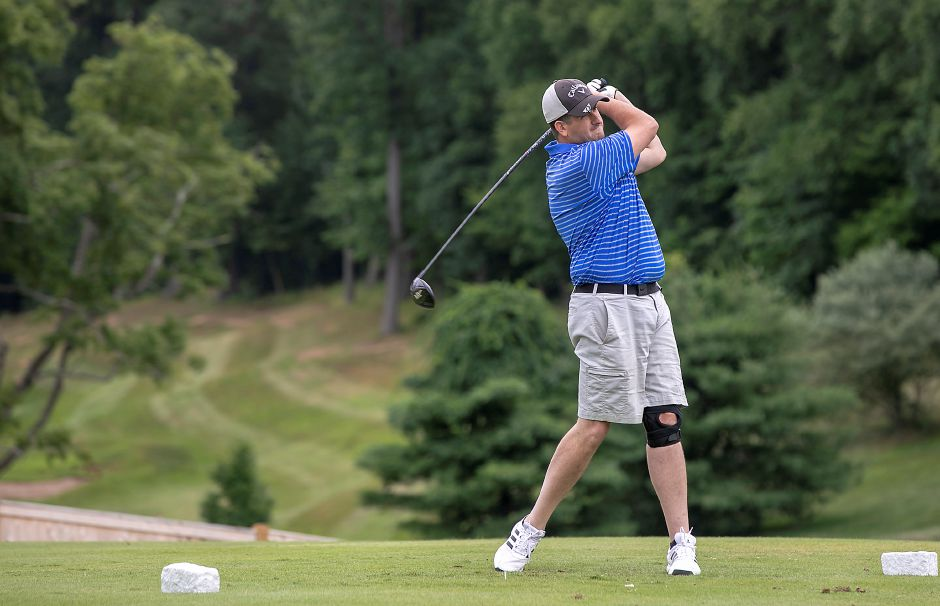 Lou DiMeo, of Wallingford, belts a drive off the first tee at Tradition Golf Club on Wednesday.