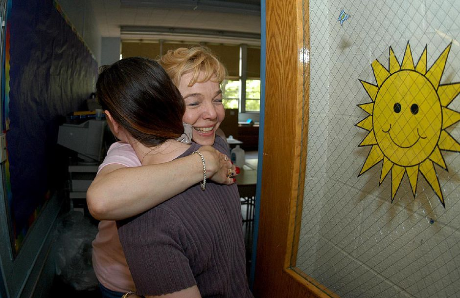 Kindergarten teacher Maureen Murphy says goodbye to Leslie Beaulac after the very last day of school as North Center Elementary School of Southington closes their doors for the last time June 18, 2004.