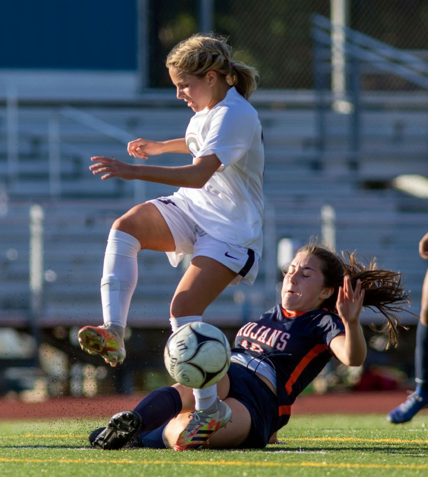 Lyman Hall's Emma Jacobs, bottom, clears the ball away from Cheshire's Ellie Pergolotti during the first half at Lyman Hall High School in Wallingford on Friday. Pergolotti scored two goals and assisted on three others in Cheshire's 8-0 victory. Aaron Flaum, Record-Journal
