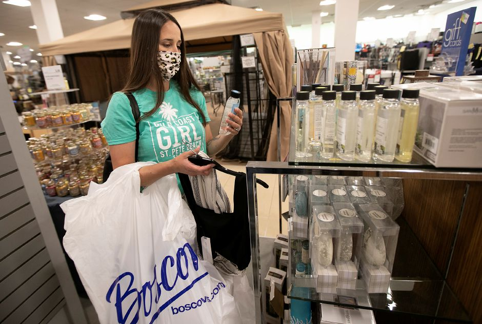 Alicia Morse, of Middletown, looks over essential oils products while shopping at Boscov's at the Westfield Meriden mall, Thurs., May 21, 2020. Boscov's department store reopened at 11 a.m. with reduced hours and new safety precautions. Dave Zajac, Record-Journal