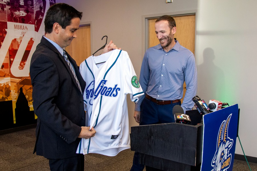 Yard Goats General Manager Mike Abramson, left, unveils a Yard Goats jersey for the team's new manager, Chris Denorfia, a Southington native, during a news conference Thursday at Dunkin' Donuts Park in Hartford. Aaron Flaum, Record-Journal