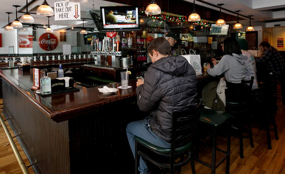 Patrons of Archie Moore's sit at the bar during lunch on Tuesday.Dave Zajac, Record-Journal