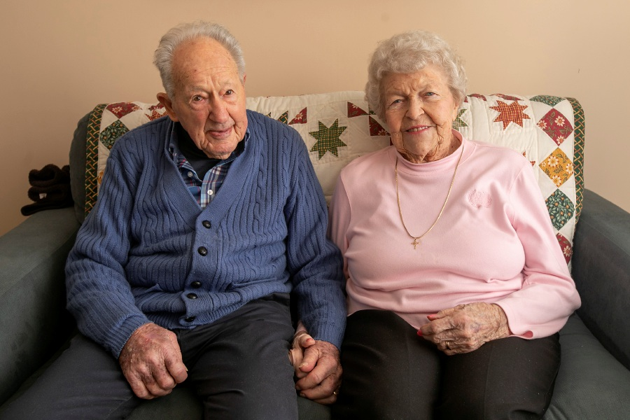 "Ruth and Bob ""Bus"" Williams hold hands Thursday on their sofa at the Bradley Home in Meriden. The couple celebrated their 75th wedding anniversary on Jan. 27. Dave Zajac, Record-Journal"