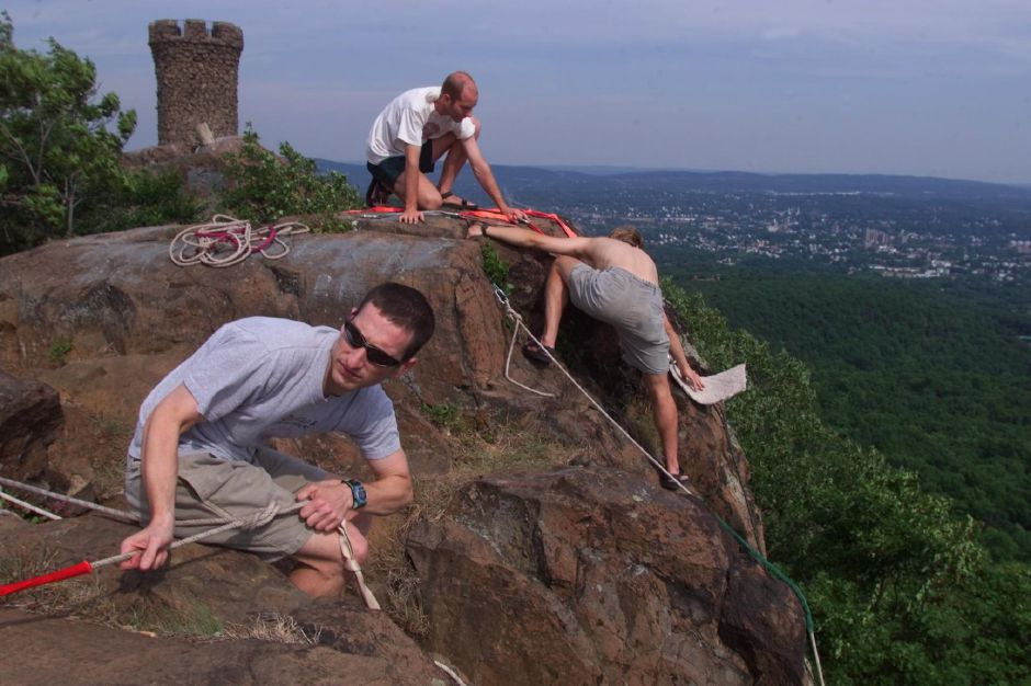 "RJ file photo - Joel Hyman, closest, Stephen Fisher, left, and Dan Price, are graduate students at Yale in New Haven just out rock climbing or ""top roping"" on the East Peak near Castle Craig in Meriden June 24, 1999."