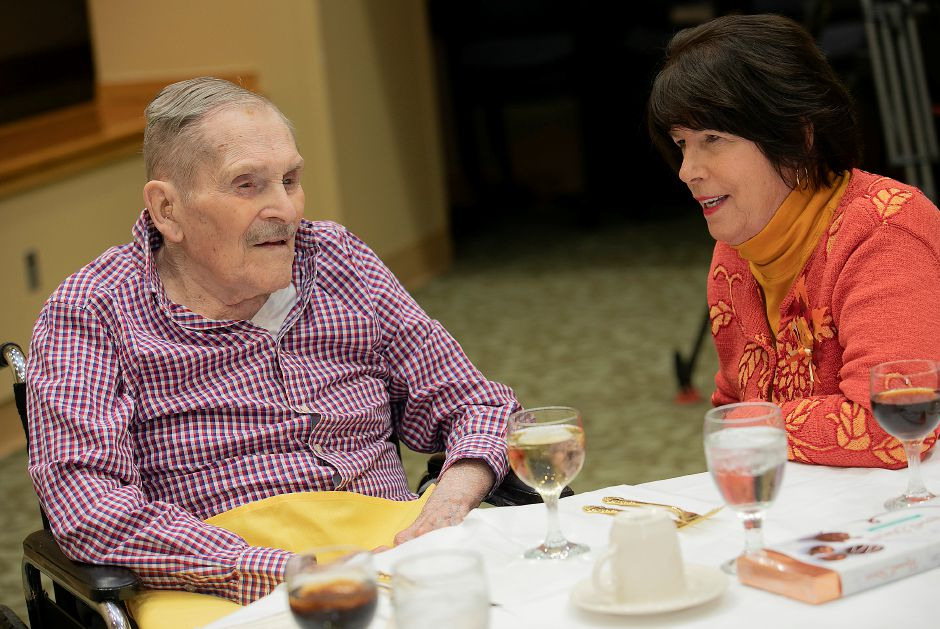 "Resident Harry Bartlett, 103, shares smiles with daughter-in-law Heidi Bartlett, of Watertown, during a ""Centenarian Celebration"" at Masonicare in Wallingford, Wed., Oct. 16, 2019. The Masonicare Health Center honored 19 centenarian residents, people who have lived for at least a century, in a celebration with friends and family. Dave Zajac, Record-Journal"