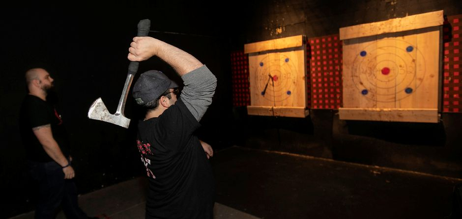 """Axepert"" Eric Yocca, right, winds up for a throw during a round with Jordan Catrone, left, of Thomaston, at Montana Nights Axe Throwing in Newington, Thurs., Jan. 23, 2020. Yocca is also a front desk clerk at the business. Montana Nights will be opening another location in the Factory Square building in Southington. Dave Zajac, Record-Journal"