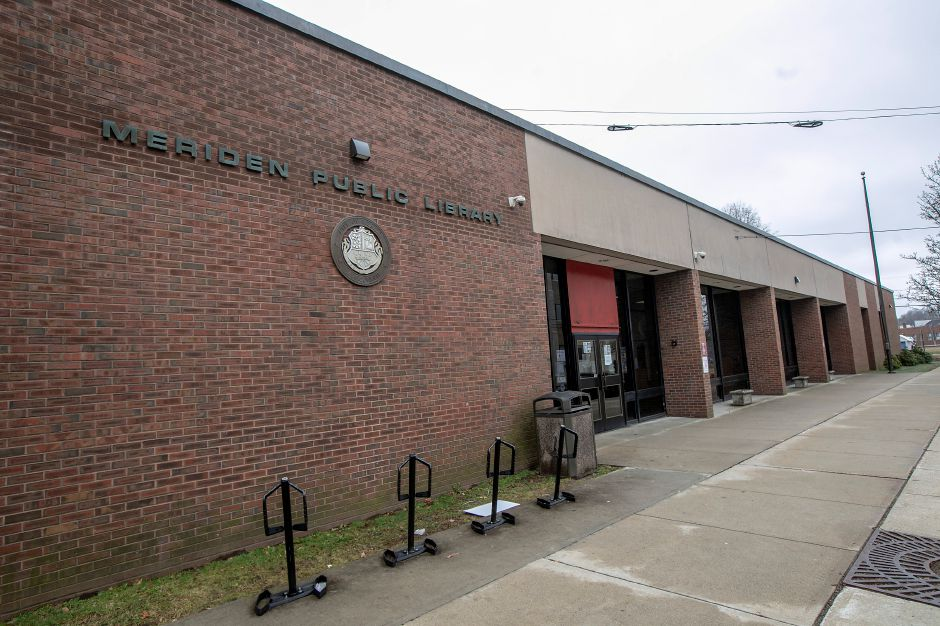 The Meriden Public Library remains closed, Thurs., Mar. 19, 2020. The library is asking to keep all items at home until at least March 31. No fines or fees will accrue according to a sign posted on the bookdrop. Dave Zajac, Record-Journal