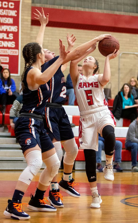 Cheshire's Kaylee Clark tries to shoot over Lyman Hall's Julia Capello left and Brianna Mik during the first half at the Cheshire High School East Gym on Tuesday, January 21, 2020. Aaron Flaum, Record-Journa