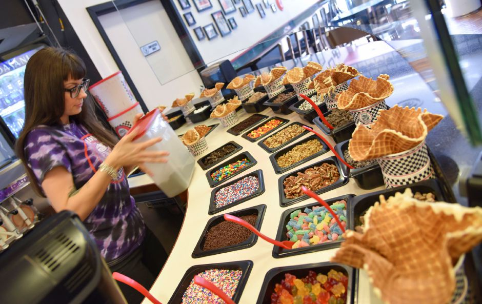 Shift manager Whitney Langford stocks up on toppings Thursday at Ashley