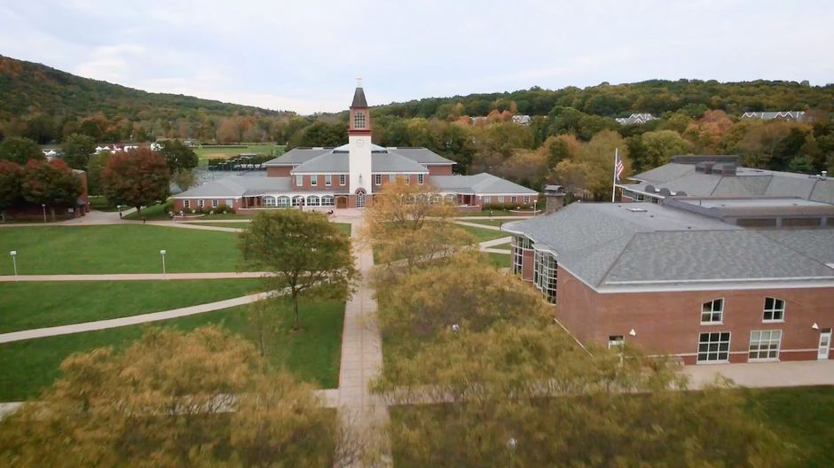 First frame of campuses page hero video. Aerial shot from drone of Mount Carmel Campus quad.