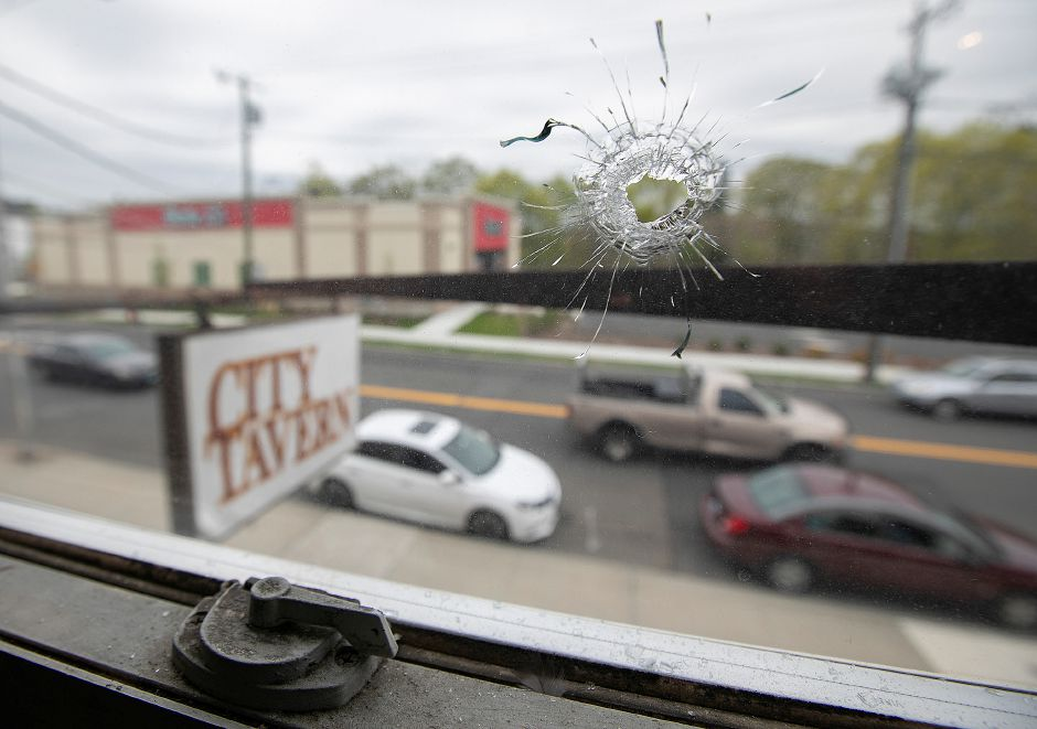 This window in an apartment over City Tavern on Broad Street in Meriden was struck by gunfire Friday night.