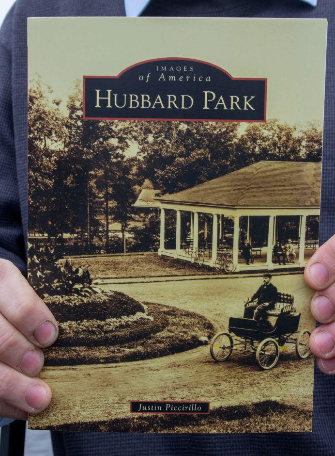 "Justin Piccirillo at Hubbard Park in Meriden on Dec 31, 2020, with his book ""Hubbard Park (Images of American).""  Aaron Flaum, Record-Journal"